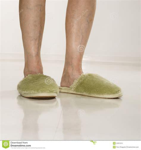 female feet wearing slippers stock  image
