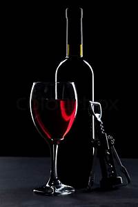 Wine glass and bottle on black background | Stock Photo ...