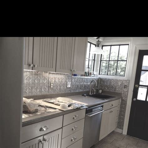 kitchen panels backsplash tin backsplash done fasade panels house and home pinterest traditional labor and the o