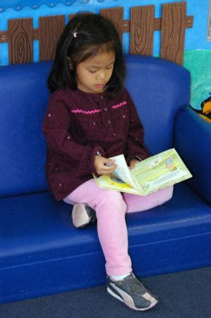 reviews from families at cadence academy preschool 794   preschool girl reading cadence academy preschool fayetteville ar 299x450