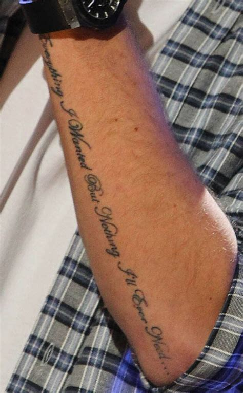 guess   direction tattoo  guess