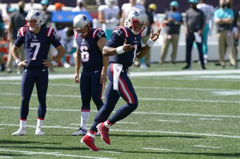 Newton runs for 2 TDs, Patriots hold off Dolphins 21-11 ...