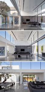 This, Minimalist, Home, Of, Double, Height, Ceilings, And, Large, Windows, Is, Filled, With, Natural, Light
