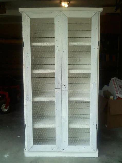 pallet bookcase  chicken wire doors bookshelves diy