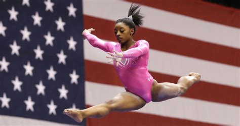 biles is named ap athlete of the year xonecole