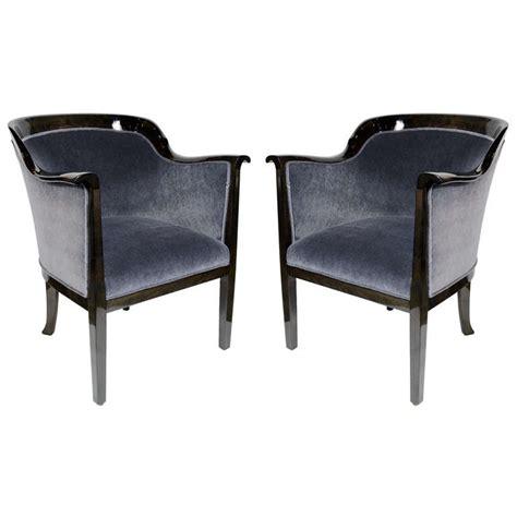 pair of deco club chairs in ebonized walnut with grey