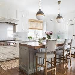 kitchen islands with chairs white paneled refrigerator next to microwave oven transitional kitchen