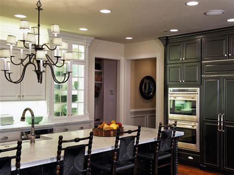 White Cottage Kitchen With Black Cabinets And Chairs Hgtv