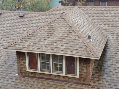 hip roofs construction paint roof dormers what homeowners should hometown