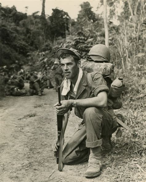 wwii soldier alert with watchful eye while others take a in burmese jungle photogr