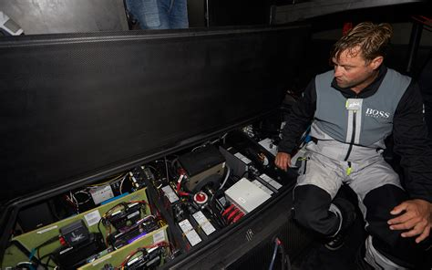 hugo boss sailing  board alex thomsons million foiling machine