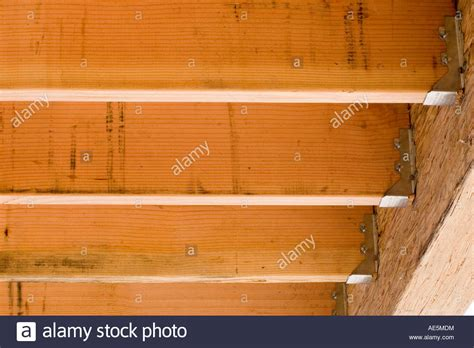 deck joist hangers or not floor joists attached to beam with joist hangers at a