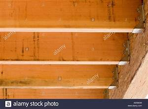 Floor joists attached to beam with joist hangers at a for Floor joist size residential