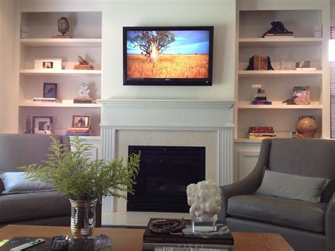 Living Room With Fireplace And Bookshelves by Built In Bookshelves And Cabinets Tv On Wall With