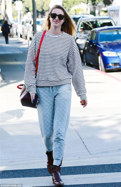 whitney port wears quilted trousers baggy striped
