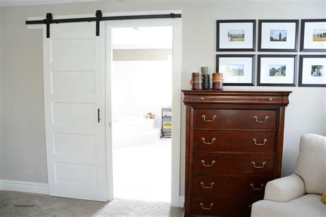 barn doors for homes interior white stained wood sliding barn door hanging on black rod
