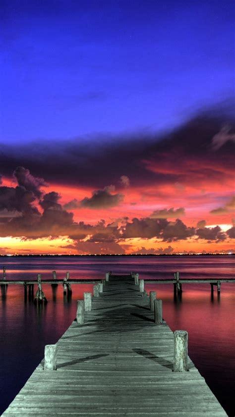 720x1280 Wallpaper sunset, landscape, sky, paint, pier ...