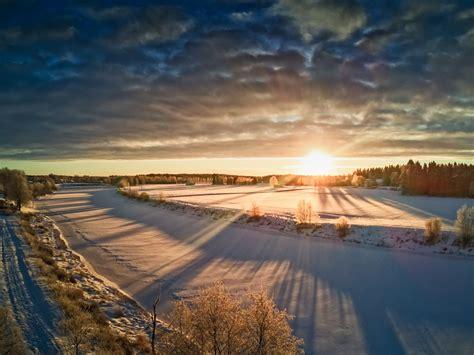 Sun Rising Over The Frozen River | Dronestagram
