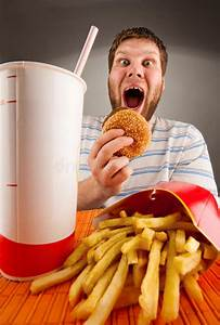 Expressive Man Eating Fast Food Stock Image