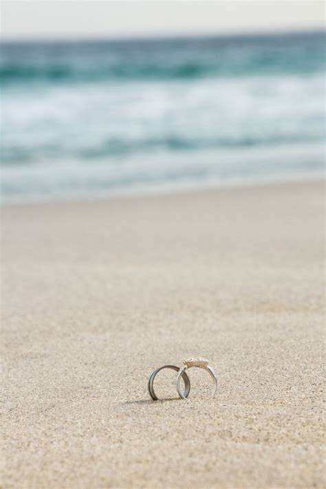 wedding rings  sand photo