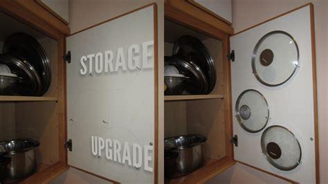 Small Kitchen Cupboard Storage Ideas - store saucepan lids inside your cabinet doors lifehacker australia
