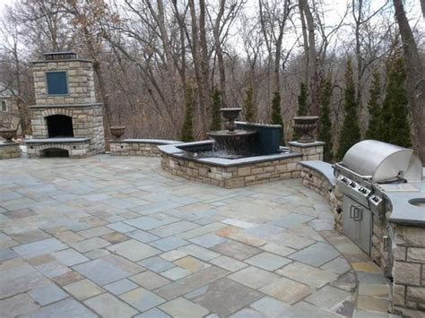 Patio, outdoor grill & fireplace, stairs, fountain