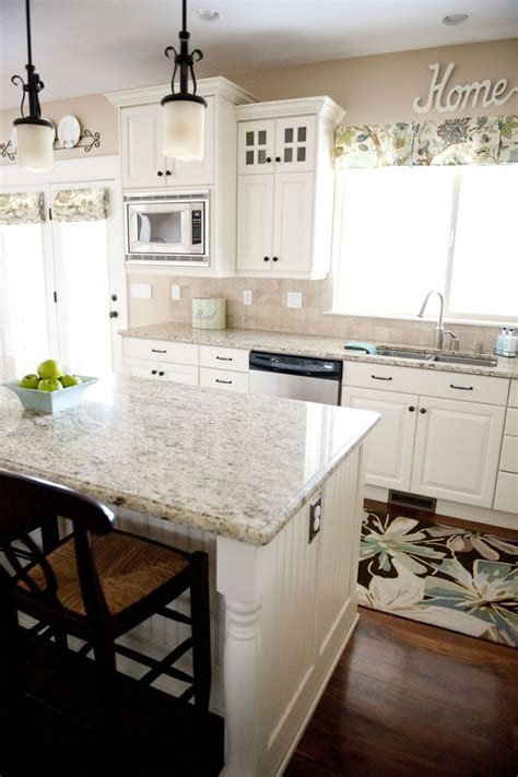 kitchen love the white with the dark hardware and the light window coverings wall color is
