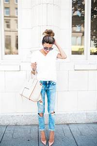 Go for a cute yet simple outfit in these ripped jeans and white tee paired with your favourite ...