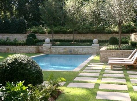 Pool Surrounded By Grass With Stone Pavers Backyard