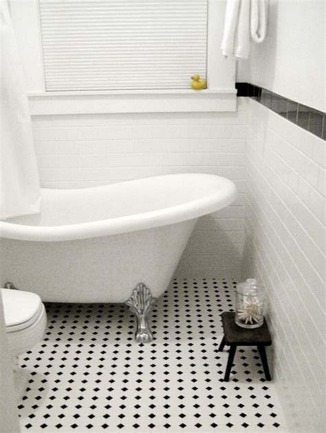 black  white tile clawfoot tub duck bathroom