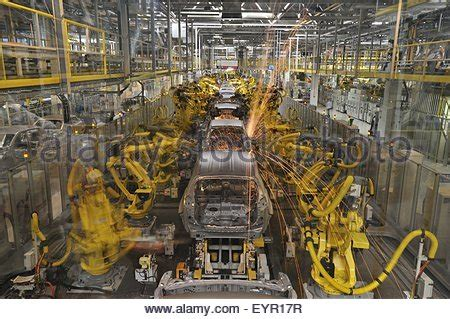 Modern Car Factory by Welding Robots Assemble The Of The New Golf 7 At The