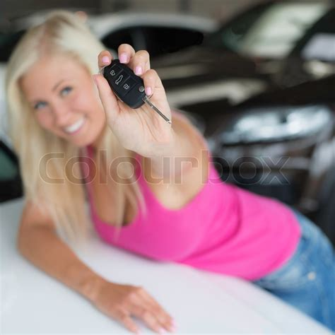young woman  pink flashing car key stock photo colourbox