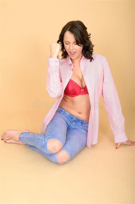 Young Woman Sitting On Floor Celebrating With Open Shirt Showing Bra Stock Image  Image Of
