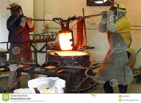 men working   foundry hot furnace royalty  stock
