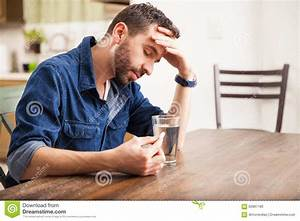 Young Man Feeling Sick At Home Stock Photo - Image: 62897180