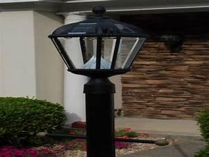 Solar powered outdoor lighting fixtures lamp posts