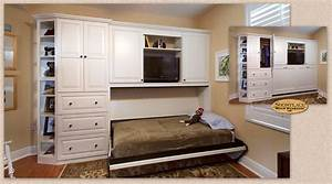 Cabinets: A custom Showplace Murphy Wall-Bed welcomes guests