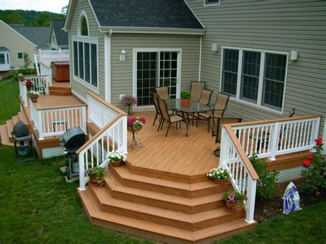 wooden deck design ideas with classic fence and square