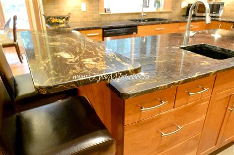 kitchen countertop raised island bar with black and gold
