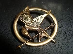 Katniss everdeen, Mockingjay pin and Mockingjay on Pinterest