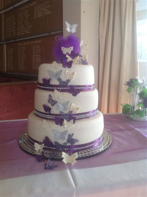Cadbury purple and Ivory butterfly wedding cake