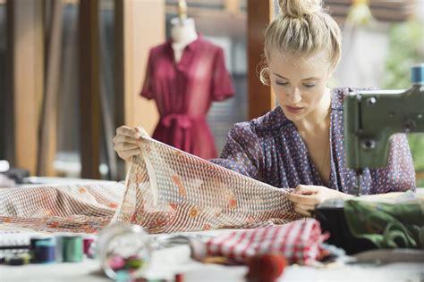 designer working sewing machine understanding serger studio jobs overlocking hero getty upscale