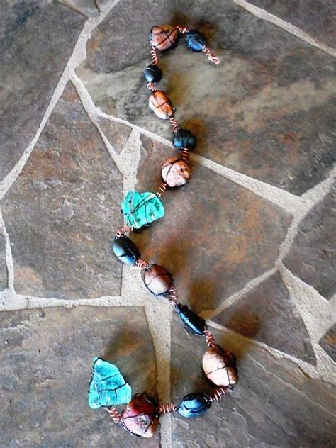 items similar  wire wrapped rock  recycled glass rain