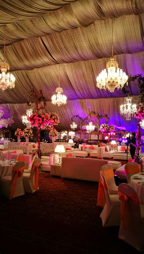 Purple Pakistani wedding reception stage decoration setup