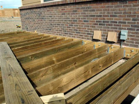 Deck Joist Hanger Jig by How To Build A Composite Deck How Tos Diy