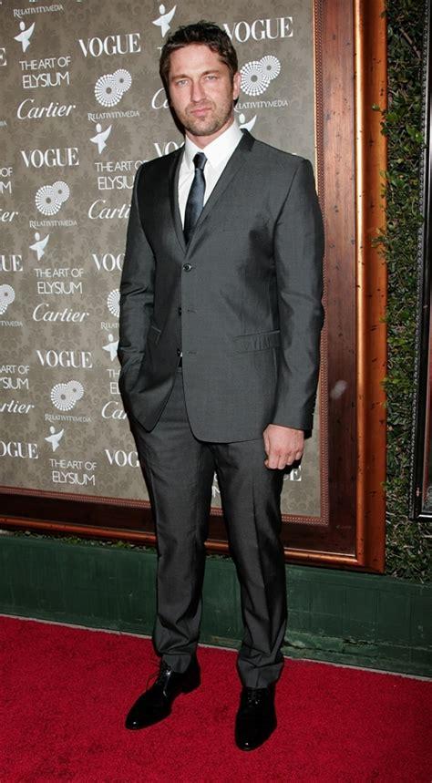 gerard butler  suit   scowl