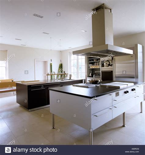 island extractor fans for kitchens modern kitchen with island and large extractor fan stock photo 10632644 alamy