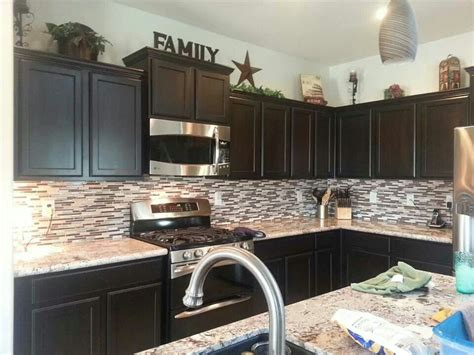 decorating ideas for top of kitchen cabinets like the decor on top of cabinets kitchen