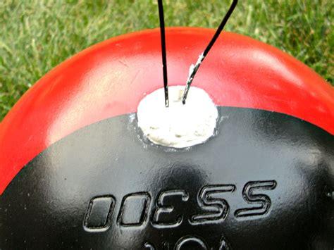 hometalk upcycled bowling ball yard art