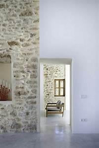 Mur En Pierre Interieur Moderne : le mur en pierre apparente en 57 photos id es deco mur en pierre maison en pierre et sol beton ~ Melissatoandfro.com Idées de Décoration